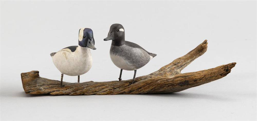 "PAIR OF D. & L. COMBS MINIATURE BUFFLEHEAD CARVINGS Mounted together on a driftwood base. Height 20.5""."