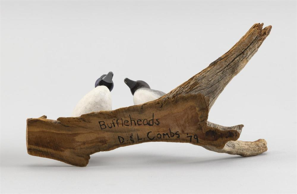 PAIR OF D. & L. COMBS MINIATURE BUFFLEHEAD CARVINGS Mounted together on a driftwood base. Height 20.5