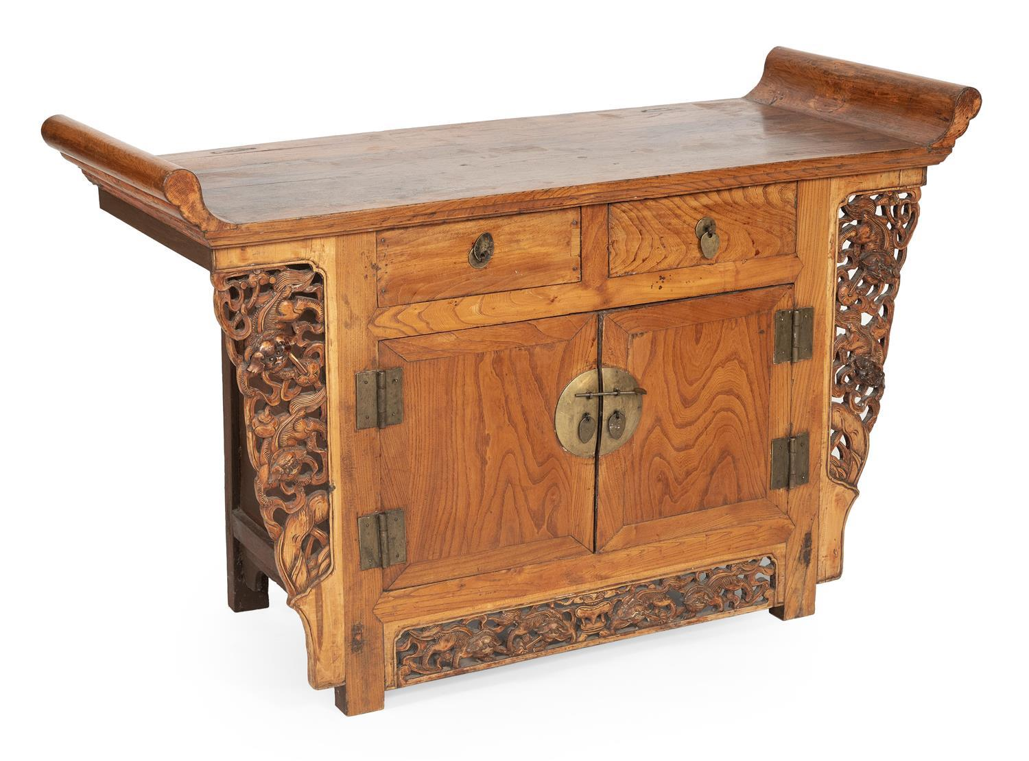 """CHINESE ALTAR TABLE In rosewood. Three side-by-side drawers with brass hardware. Sides with carved floral decoration. Height 34"""". Wi..."""