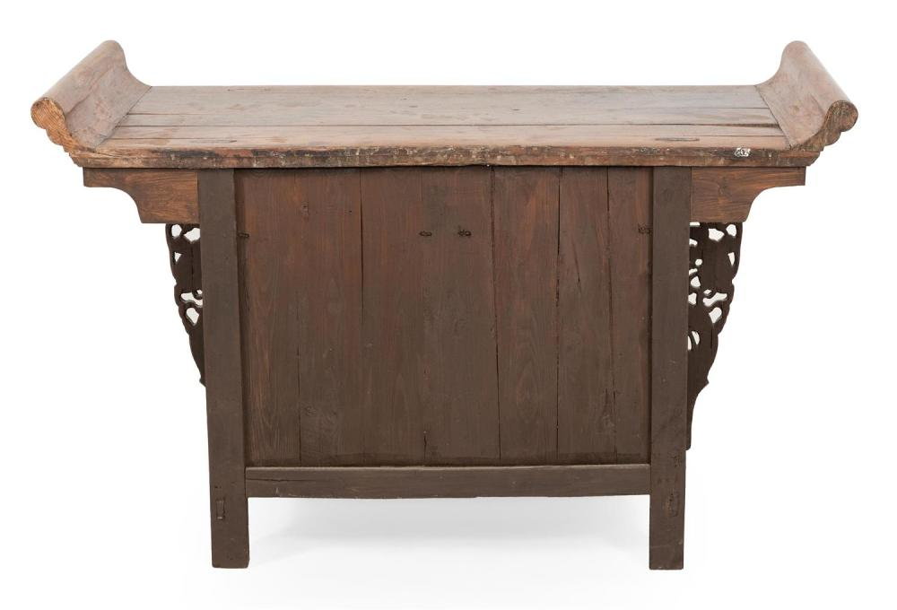 CHINESE ALTAR TABLE In rosewood. Three side-by-side drawers with brass hardware. Sides with carved floral decoration. Height 34