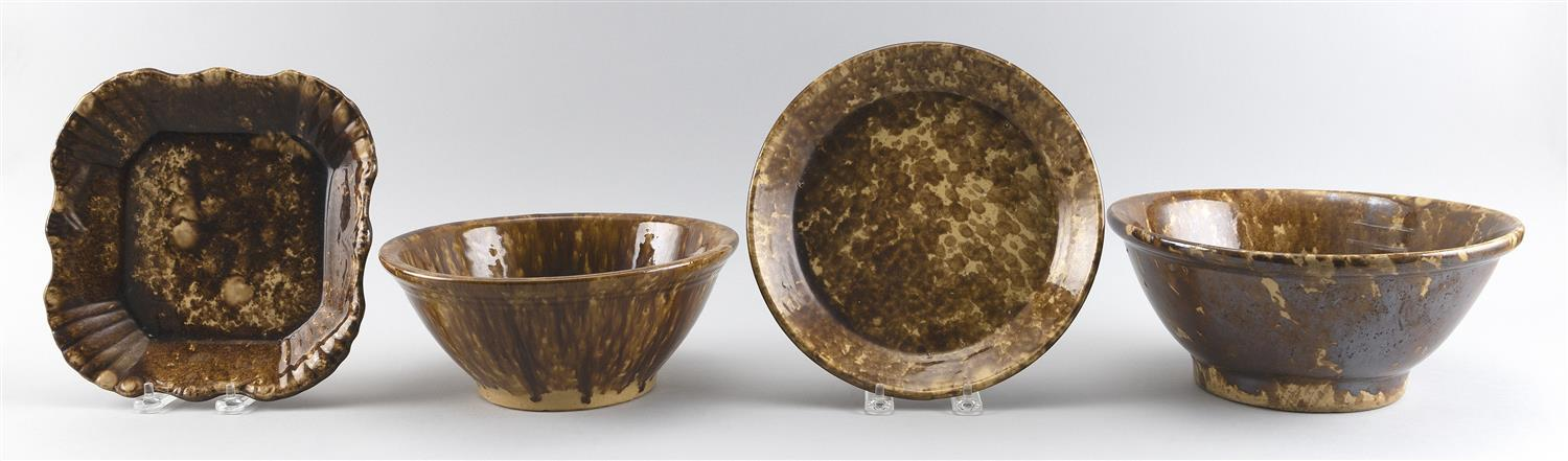 """FOUR PIECES OF BENNINGTON POTTERY Two bowls, a shallow plate and a pie plate with shell decoration. Height of largest 3.5"""". Length 9""""."""