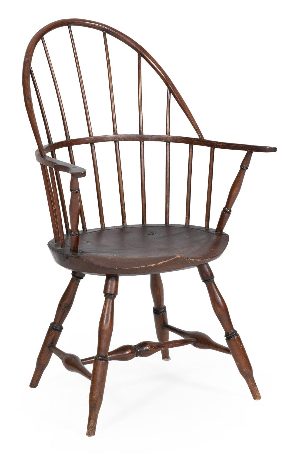 "WINDSOR BOWBACK ARMCHAIR Hardwood under an old deep brown finish. Back height 38.25"". Seat height 17.25""."