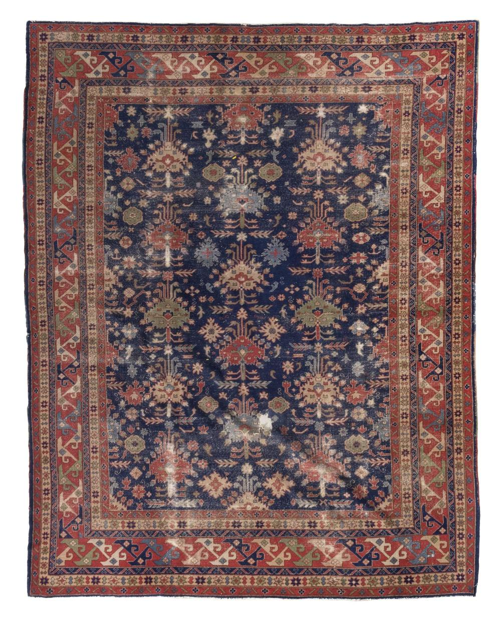 "ORIENTAL RUG: SPARTA 9'1"" x 11'9"" In a Caucasian design. Three columns of a variety of light blue, pale green, red and tan stylized.."