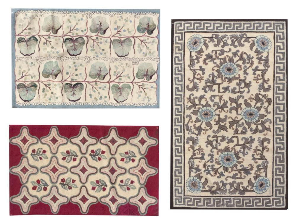 "THREE HOOKED RUGS 27"" x 44.5"", 33"" x 43.5"" and 34.5"" x 55"" One with roses and geometric shapes on a white and red ground, one with a..."