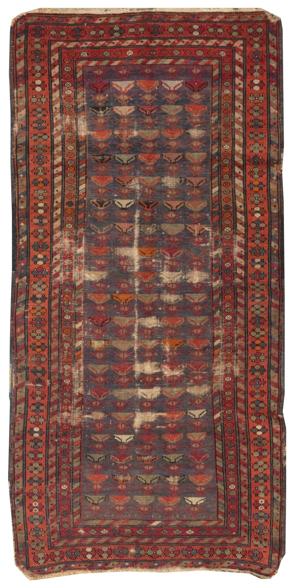 """ORIENTAL RUG: CAUCASIAN 2'10"""" x 5'11"""" Blue-gray field features five columns of a stylized element rendered in dark red, orange, gree."""