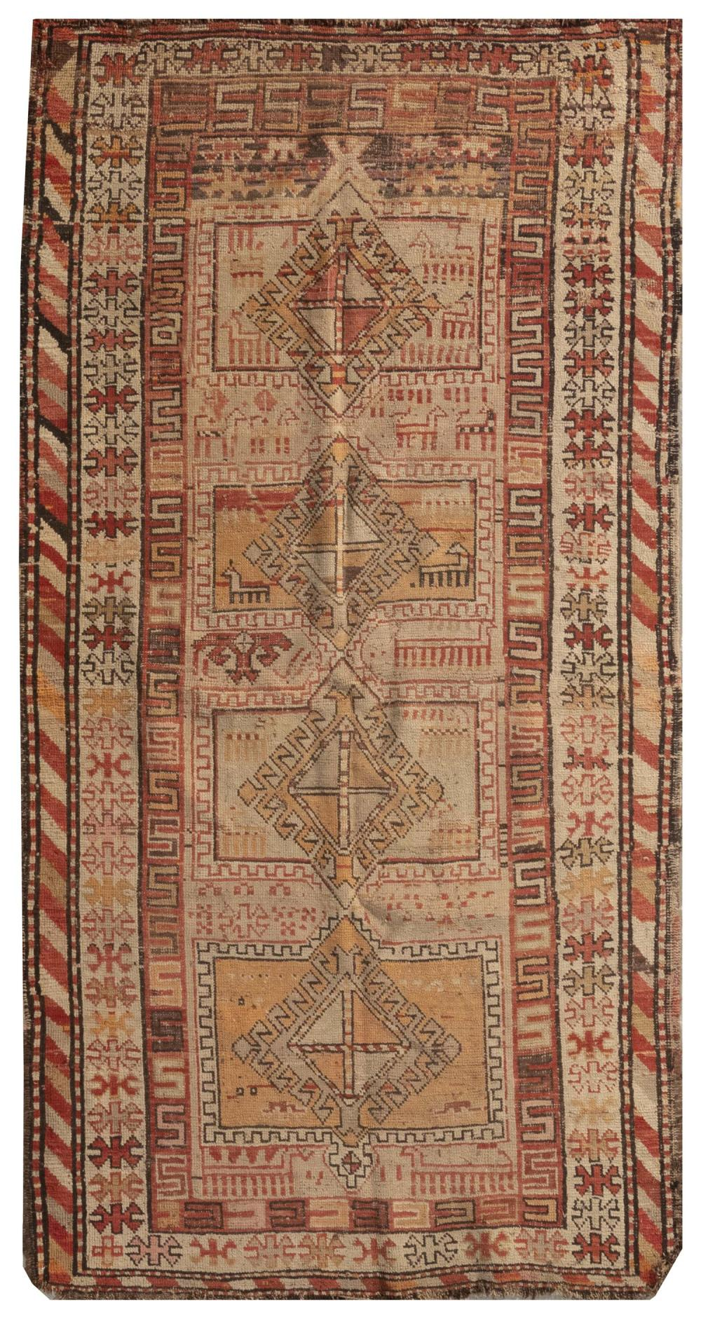 "ORIENTAL RUG: TURKISH 3'6"" x 6'9"" Four geometric medallions in faded shades of red, orange and ivory share an ivory field with numer."