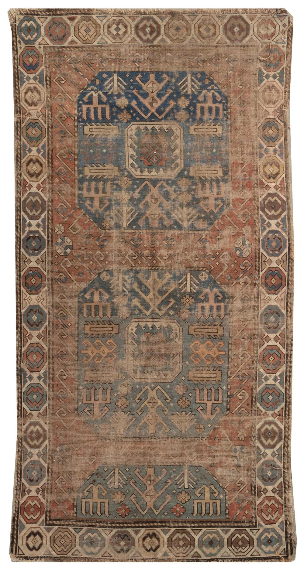 """ORIENTAL RUG: KAZAK 3'4"""" x 6'8"""" Bold blue and ivory geometric medallions on a faded red field full of stylized elements. Broad ivory."""