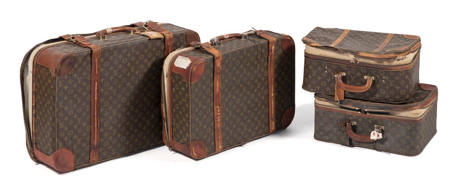 """FOUR LOUIS VUITTON SUITCASES Lengths from 18"""" to 26""""."""