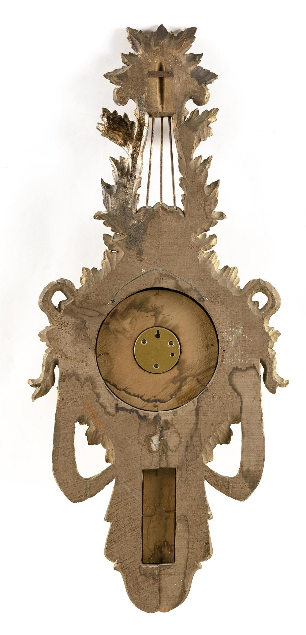 DECORATIVE WALL BAROMETER In lyre and ribbon form. Gilt painted decoration. Height 39
