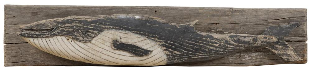 "DRIFTWOOD SCULPTURE OF A WHALE Painted white and black. Mounted on a wooden backboard. 7"" x 31""."