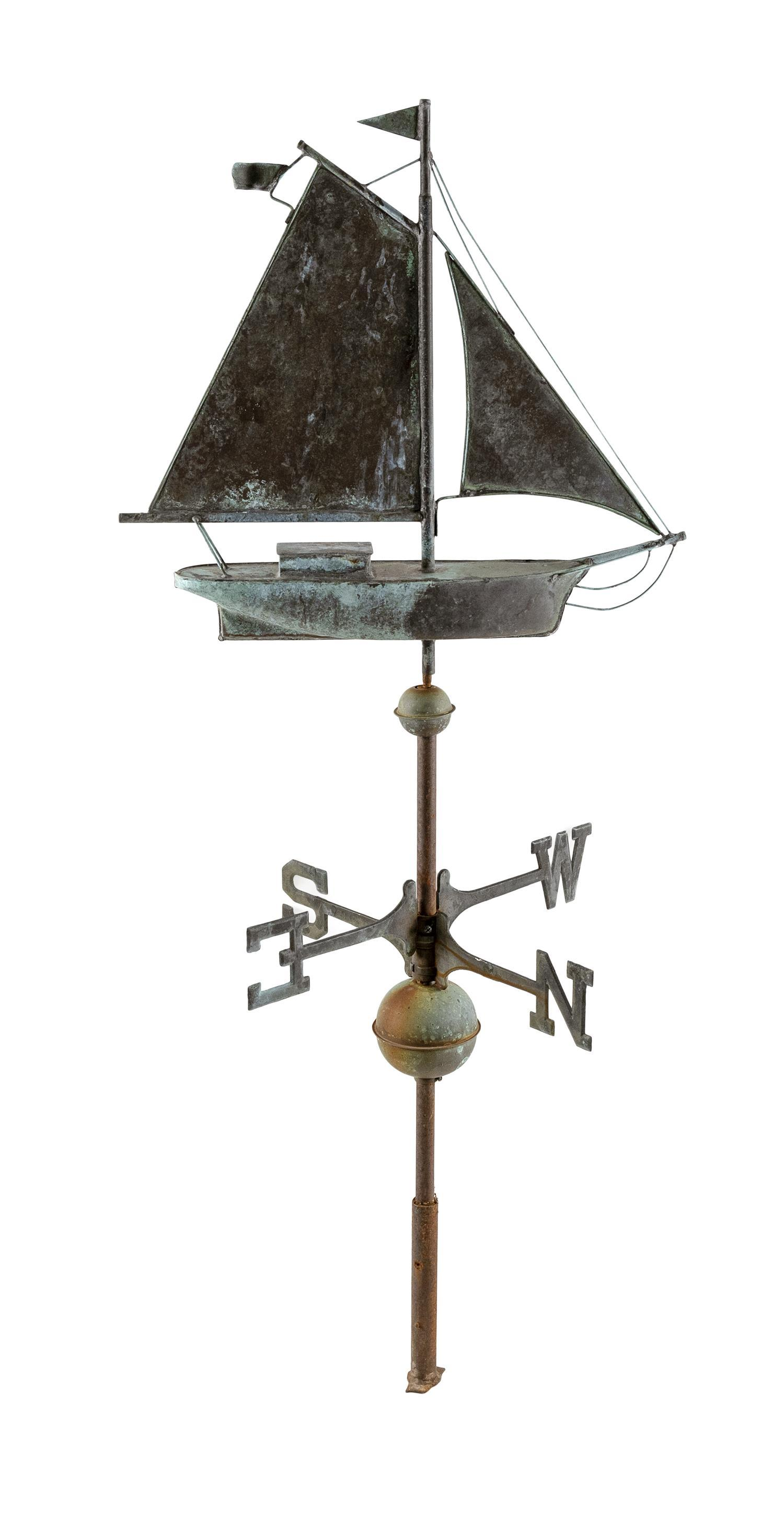 """COPPER AND ZINC WEATHER VANE IN THE FORM OF A GAFF-RIGGED VESSEL On a pole with finders. Total height 52"""". Length 22""""."""