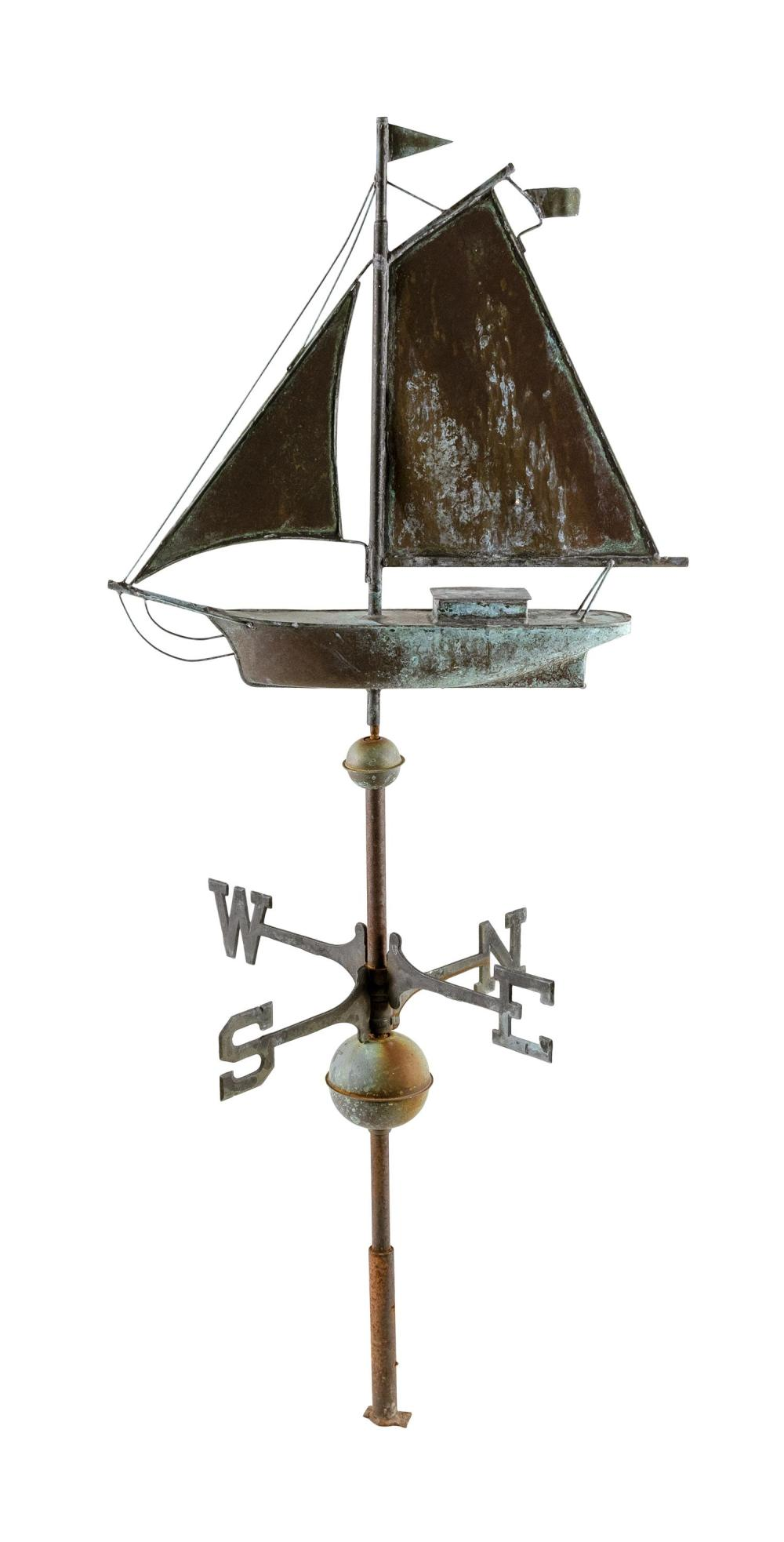 COPPER AND ZINC WEATHER VANE IN THE FORM OF A GAFF-RIGGED VESSEL On a pole with finders. Total height 52