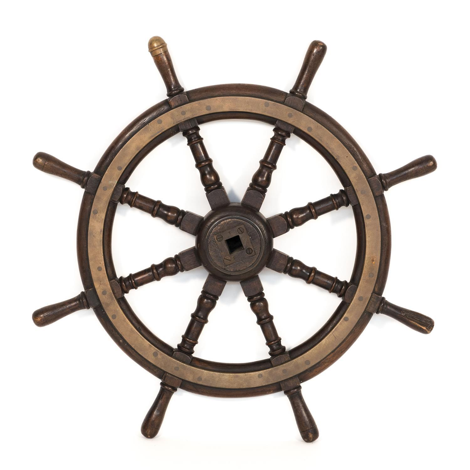 "EIGHT-SPOKE YACHT WHEEL With brass band and hub. Diameter 33""."