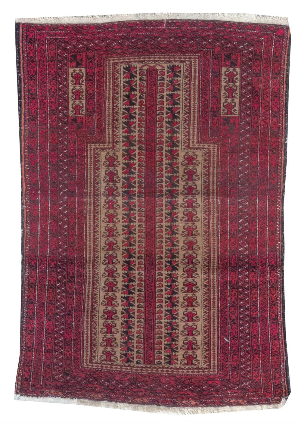 "ORIENTAL RUG: BELOUCH PRAYER 2'11"" x 4'4"" Tan geometric field and mihrab traversed by columns of black and dark red traditional styl."