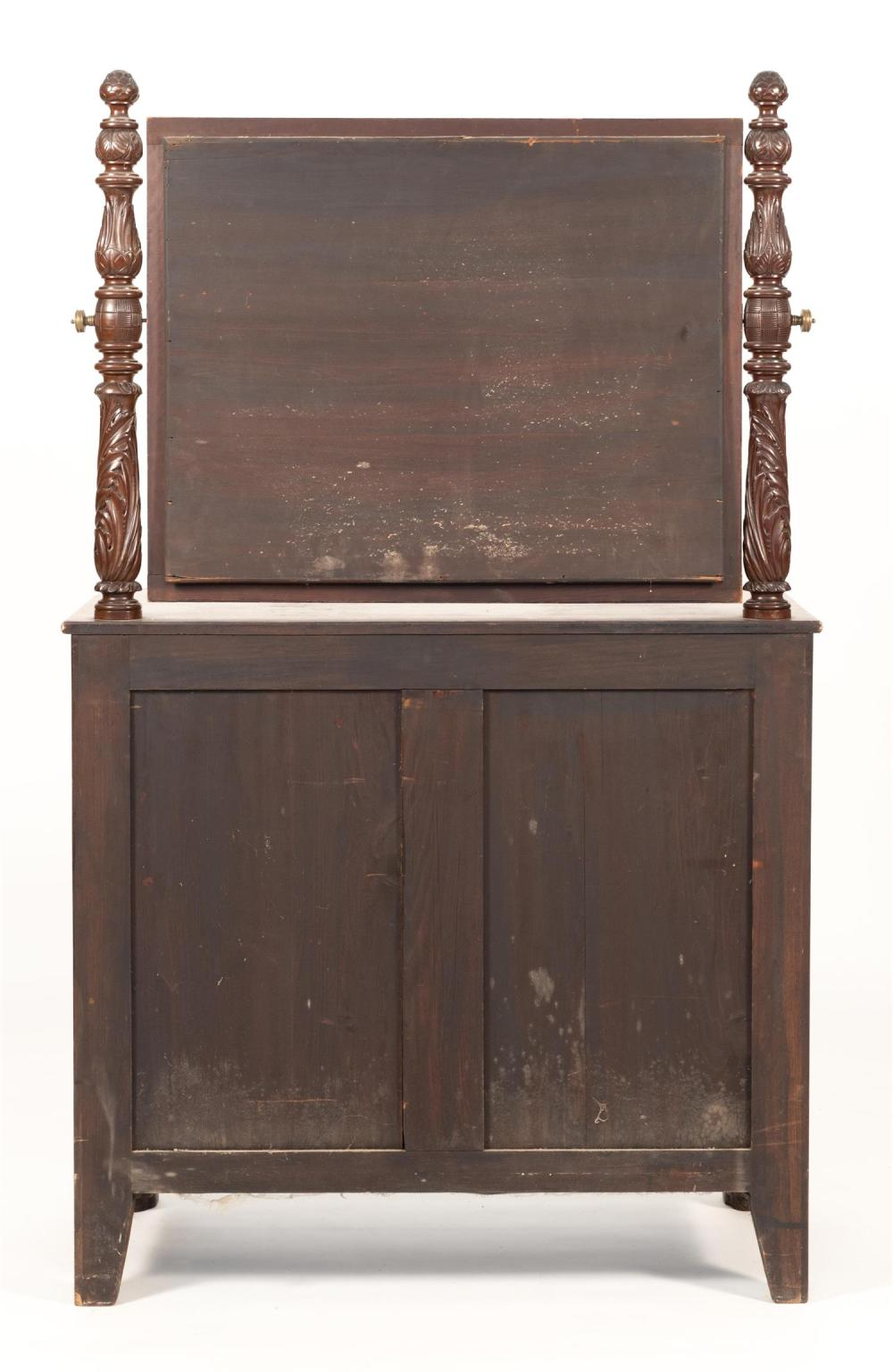 EMPIRE DRESSER In mahogany and mahogany veneer. Mirrored back with acanthus-carved posts. Two half drawers over three full-width dra...