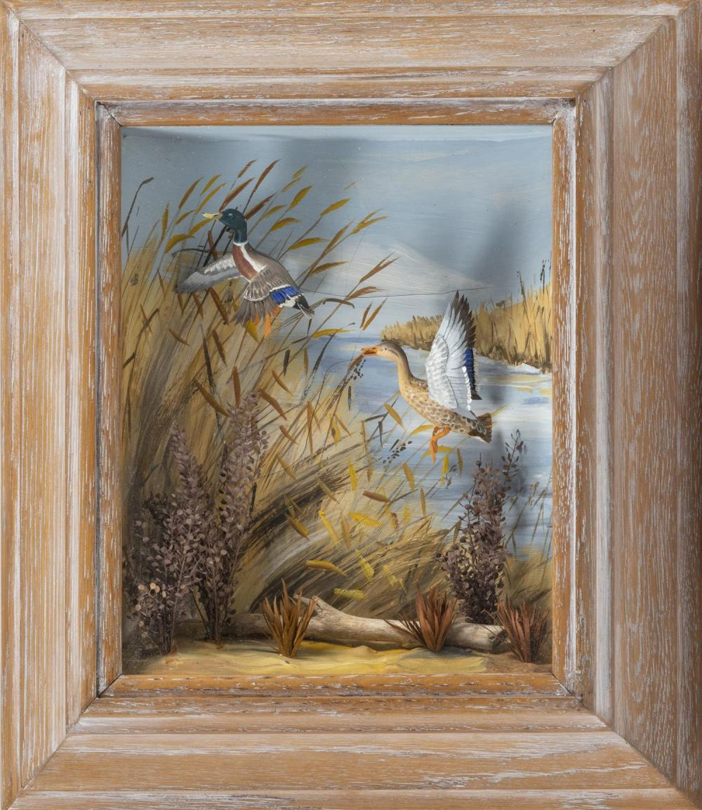 SHADOW BOX DIORAMA OF MALLARDS IN FLIGHT BY R.G. RODELL Pair of carved and painted mallards in a marsh scene, with a branch and foli...