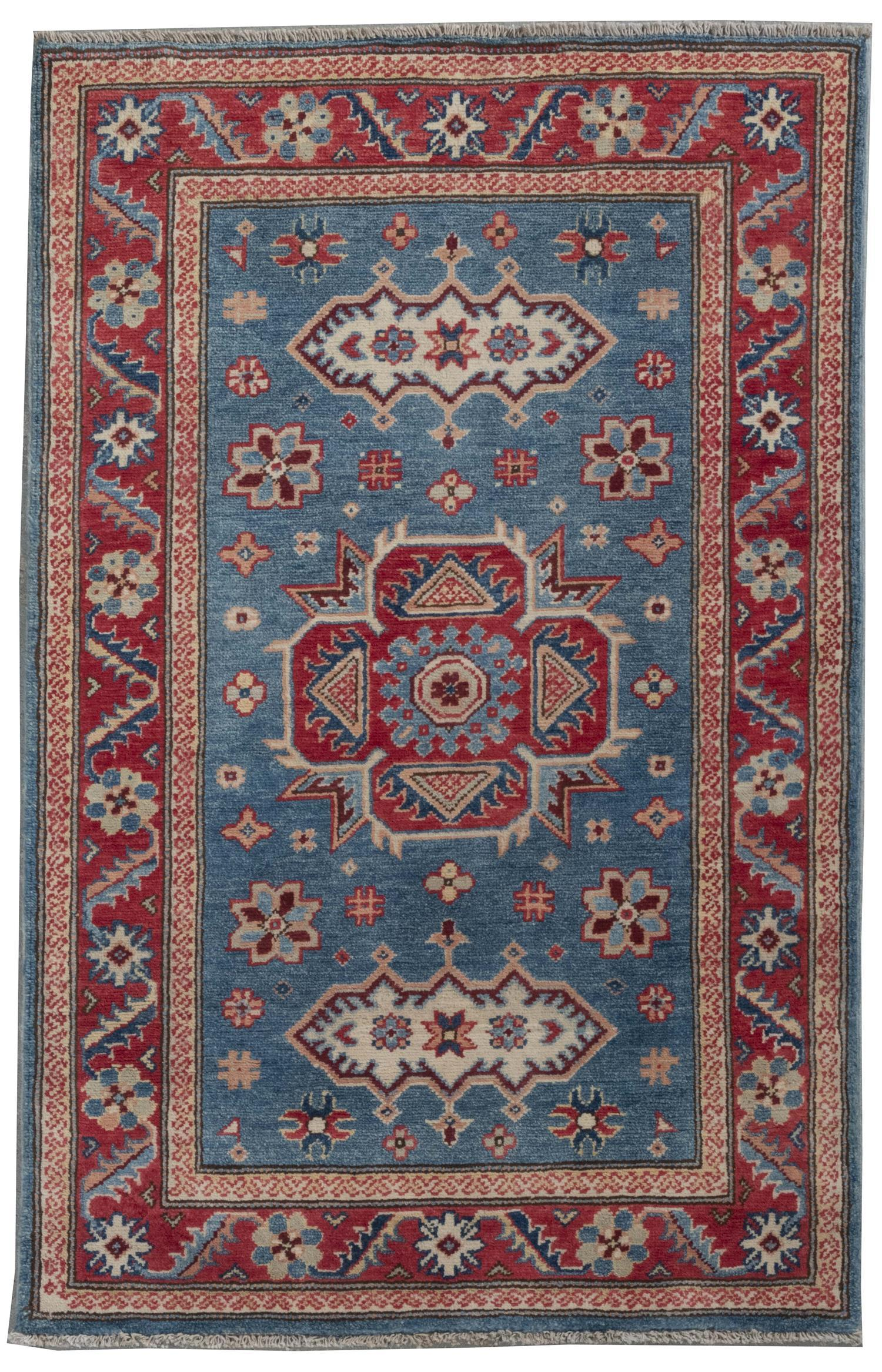 """ORIENTAL RUG: KAZAK DESIGN 3'1"""" x 4'9"""" Pale green and bright red geometric medallions contain, and are surrounded by, blue, gold and."""