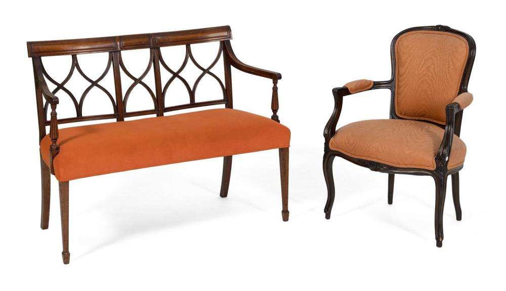 SHERATON-STYLE LOVE SEAT AND A LOUIS XV-STYLE ARMCHAIR 1) Love seat in mahogany and mahogany veneer, with pierced back and spade fee...