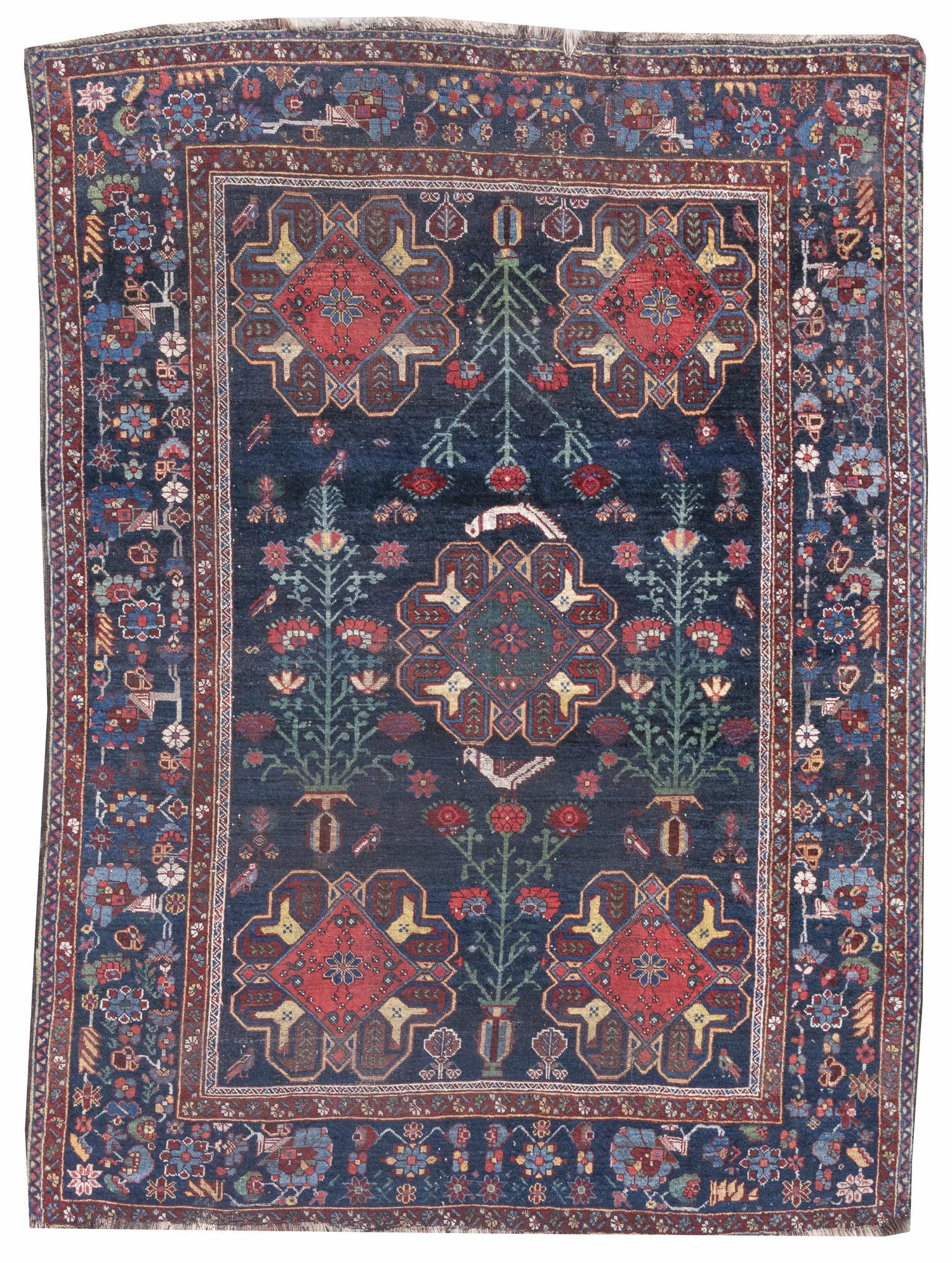 """ORIENTAL RUG: AFSHAR 5'6"""" x 7'6"""" Bold red, green, blue and yellow geometric medallions share a dark blue field with flower pots bear."""