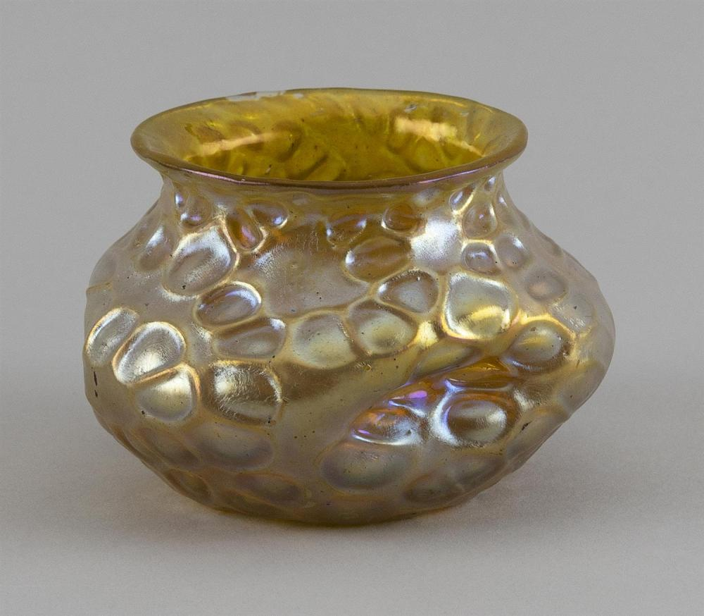 """FAVRILE-STYLE ART GLASS BOWL In dimpled ovoid form. Mottled finish. Signed """"L.C.T."""" on base. Height 2.5"""". Diameter 2.75""""."""
