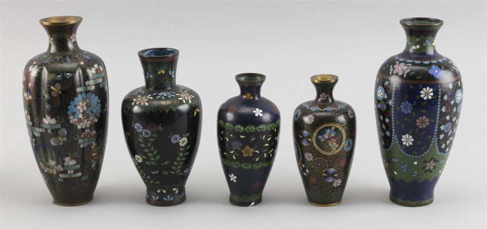 """FIVE JAPANESE CLOISONNÉ ENAMEL VASES Each in baluster form with floral and bird designs. One with a ribbed body. Heights from 5"""" to 6""""."""