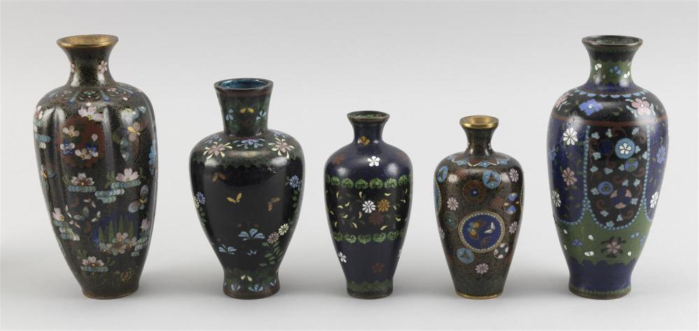 FIVE JAPANESE CLOISONNÉ ENAMEL VASES Each in baluster form with floral and bird designs. One with a ribbed body. Heights from 5