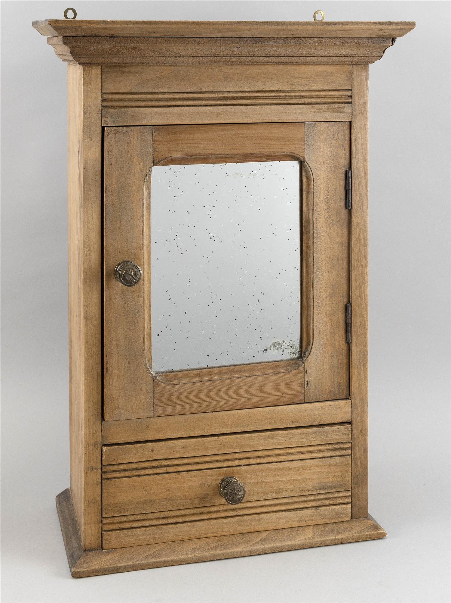 """SMALL HANGING CABINET In poplar under a natural finish. Paneled door with an inset mirror over a single drawer. Height 21.5"""". Width..."""