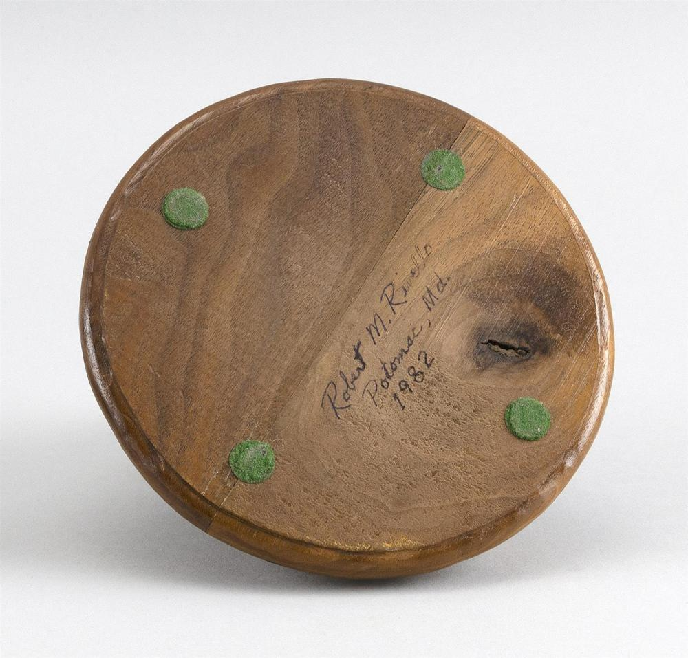 ROBERT RIVELLO LIFE-SIZE CARVING OF A SPARROW Mounted on a circular wooden base. Signed and dated on underside. Height 5.5