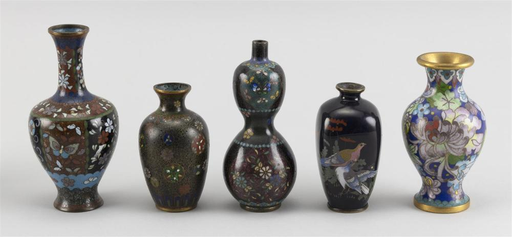 """FIVE ASIAN CLOISONNÉ ENAMEL VASES Varied shapes and floral and butterfly decoration. Heights from 4"""" to 5.5""""."""