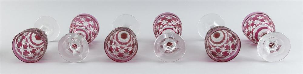 SET OF SIX CRANBERRY-CUT-TO-CLEAR CRYSTAL WINE GOBLETS Cut diamond cross and daisy bowls. Heights 7