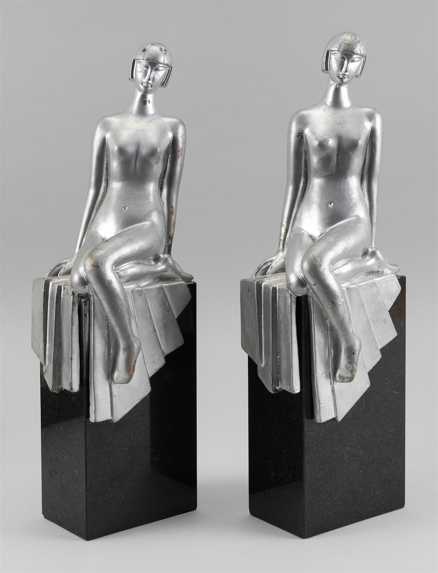 """PAIR OF ART DECO-STYLE BOOKENDS Silvered composite nude women seated on black granite bases. Unmarked. Heights 14.5""""."""