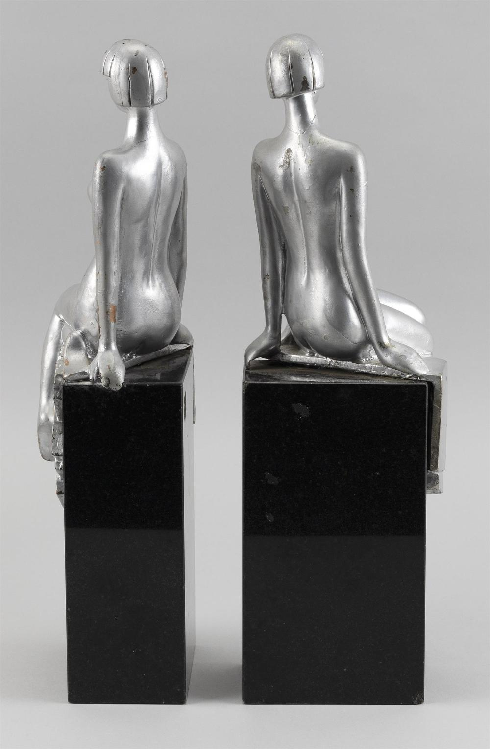 PAIR OF ART DECO-STYLE BOOKENDS Silvered composite nude women seated on black granite bases. Unmarked. Heights 14.5