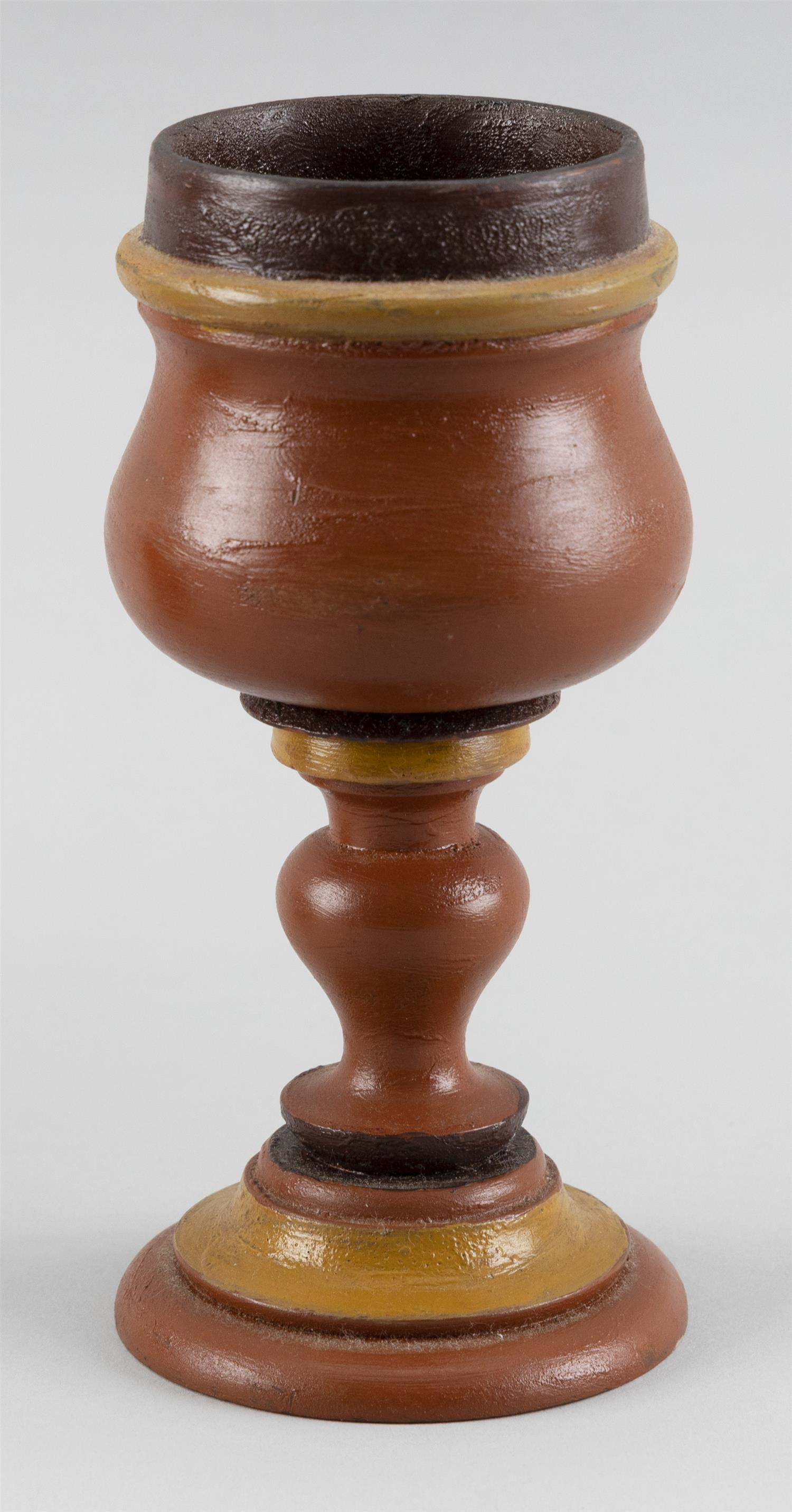 "PAINTED WOODEN GOBLET Painted red, orange and yellow. Height 6.5""."