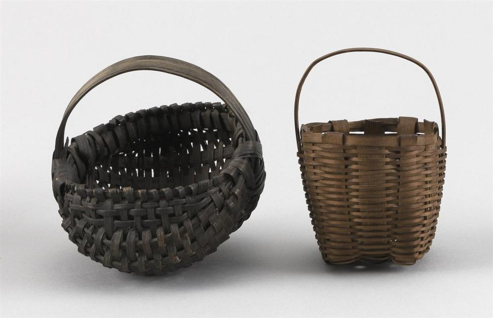 TWO MINIATURE BASKETS A buttocks basket and an egg basket. Heights 3.5