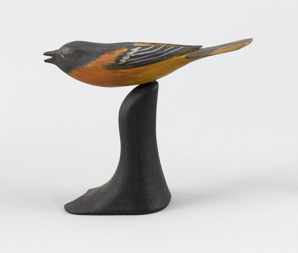 MINIATURE BALTIMORE ORIOLE CARVING Maker unknown. Mounted on a black wooden base. Height 4