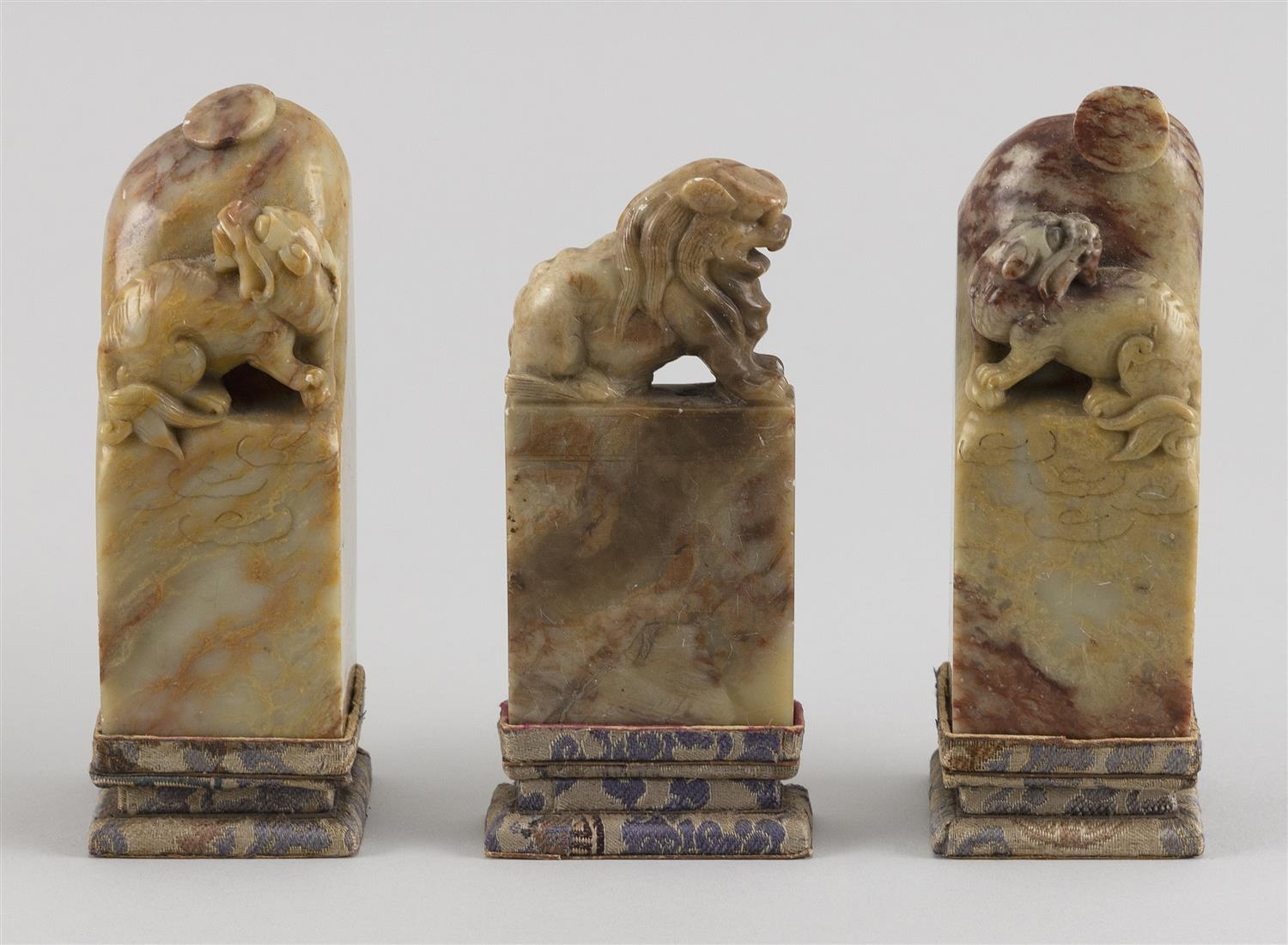 """THREE CHINESE HARDSTONE SEALS With foo dog decorations. Heights from 4"""" to 4.5""""."""