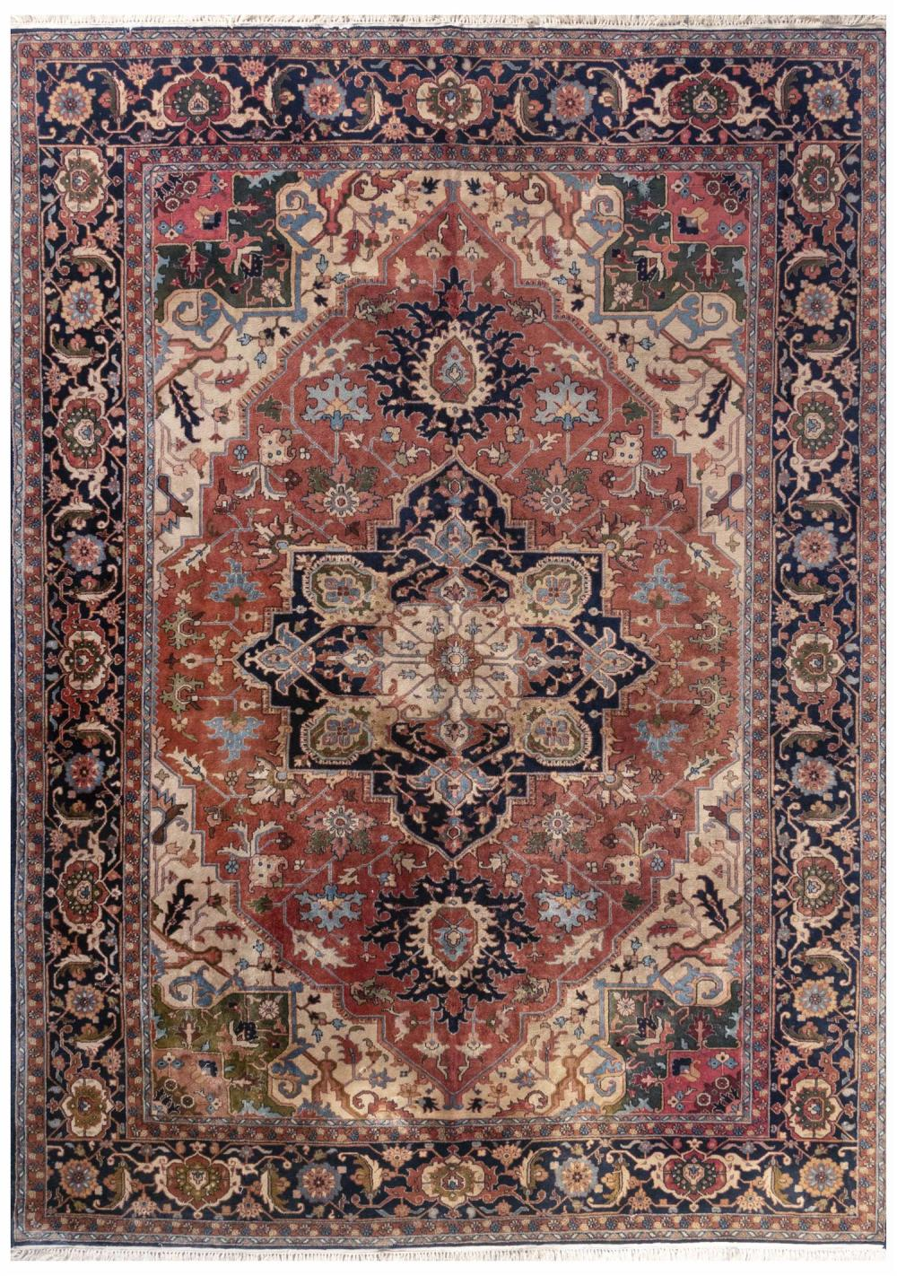"""ORIENTAL RUG: SERAPI DESIGN 9'11"""" x 13'9"""" Rust-red field with a blue and ivory gabled medallion that contains green, gold and rust-r."""