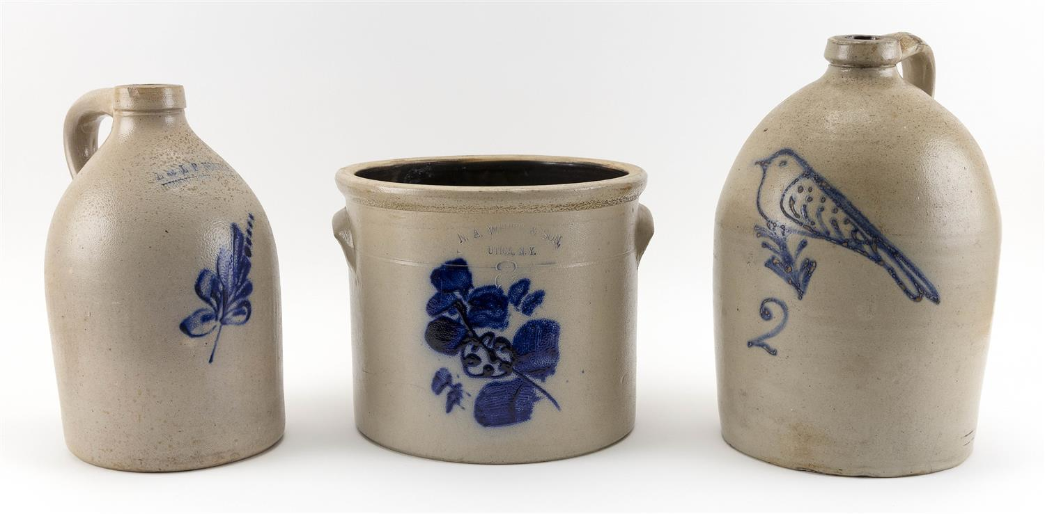 THREE PIECES OF STONEWARE 1) Two-handled crock marked for N.A. White & Son, Utica, New York. Cobalt blue floral decoration. Height 9...