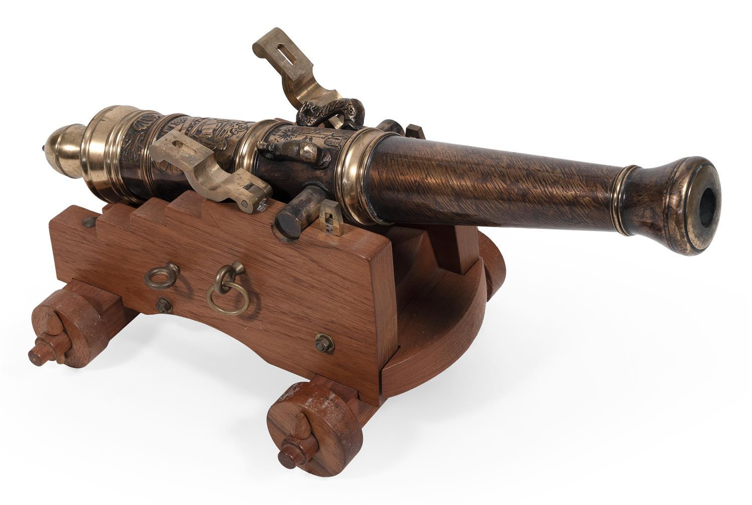 "MODERN COPY OF AN 18TH CENTURY BRASS CANNON MODEL Mounted on a wooden carriage. Length 25"". Not intended to be used as a signal cann..."