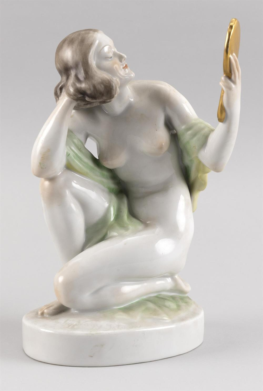 """HEREND PORCELAIN FIGURE OF A NUDE WOMAN HOLDING A MIRROR Factory marks and numbered 5724. Height 9.25""""."""