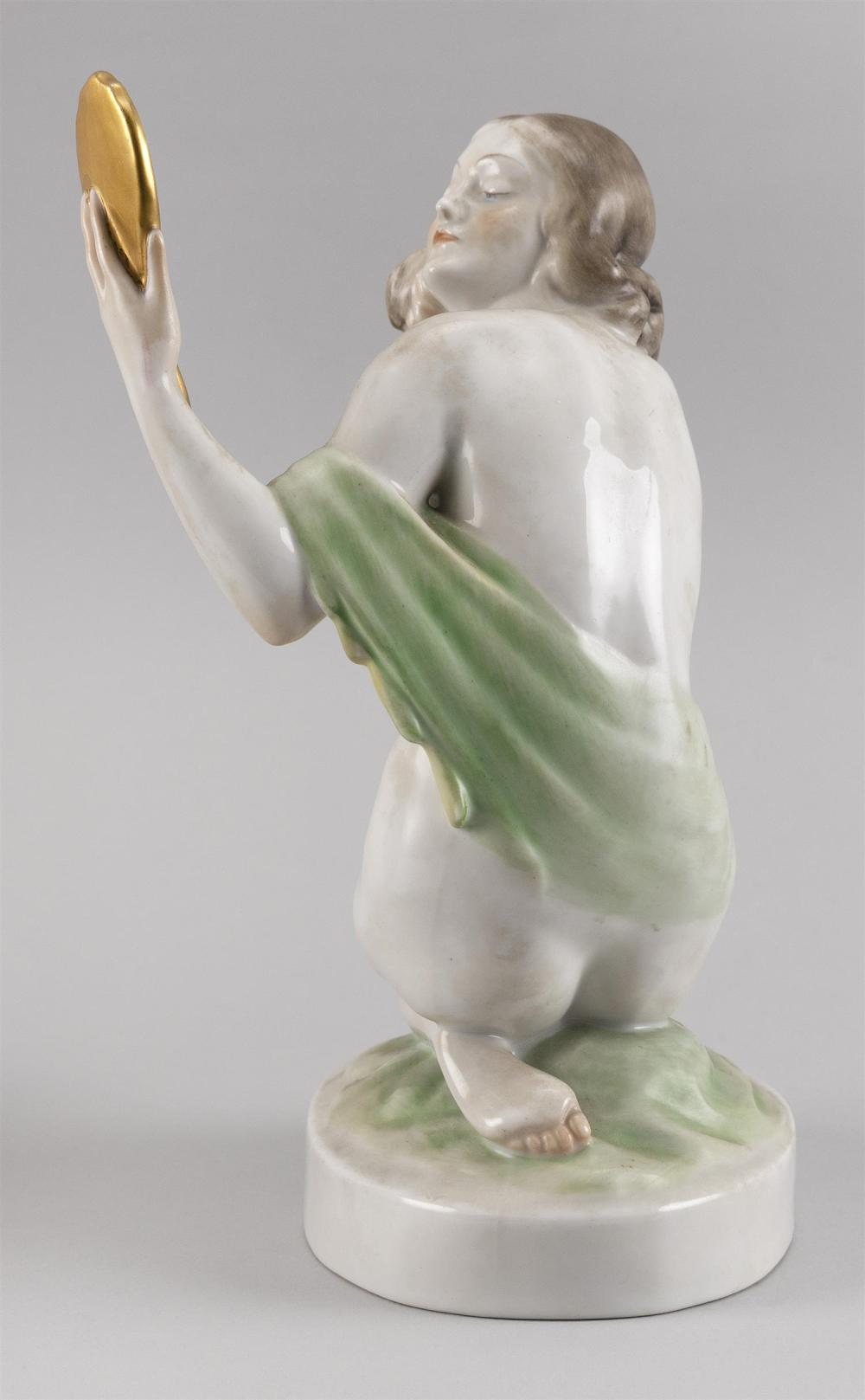 HEREND PORCELAIN FIGURE OF A NUDE WOMAN HOLDING A MIRROR Factory marks and numbered 5724. Height 9.25