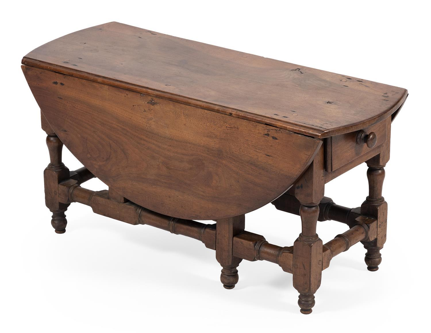 """DIMINUTIVE DROP-LEAF TABLE In walnut, made up of old parts. Height 15.5"""". Length 11.5"""" plus two 10"""" leaves. Width 32""""."""