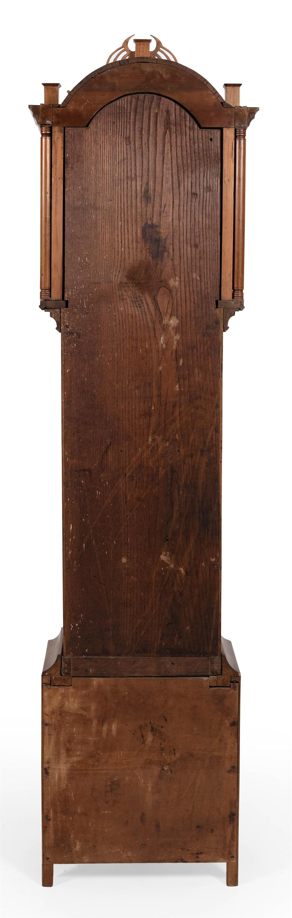 TALL-CASE CLOCK ATTRIBUTED TO SILAS HOADLEY Cherry case. Bonnet with three plinths joined by pierced fretwork, and an arched glazed...
