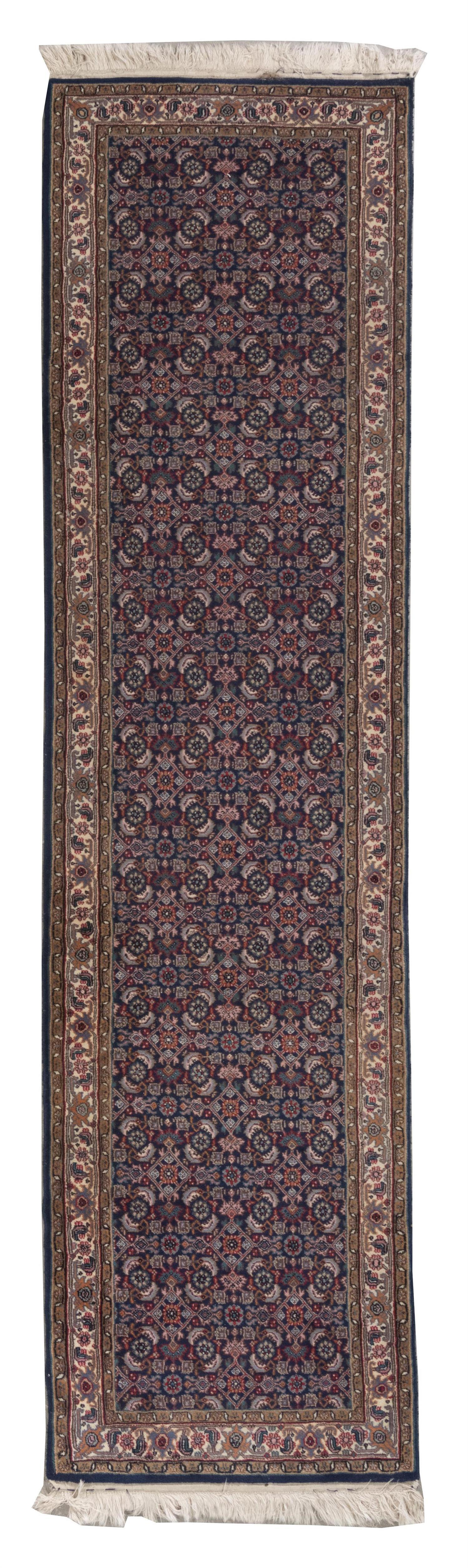 "ORIENTAL RUG: BIDJAR DESIGN RUNNER 2'6"" x 9'9"" Navy blue field with three columns of red, pink, pale blue, emerald green, and subtle."