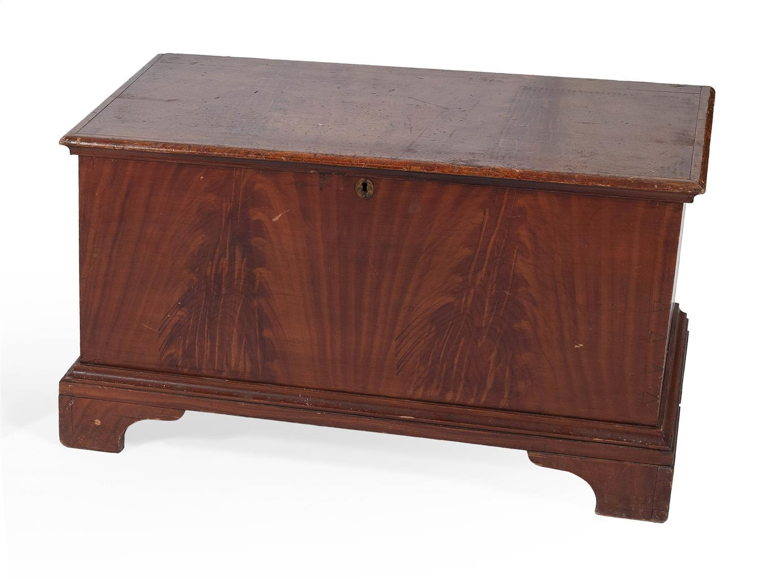 PENNSYLVANIA LIFT-TOP CHEST In pine, with red and brown grain-painted decoration. Shaped lid attached with iron hinges. Shaped brack...