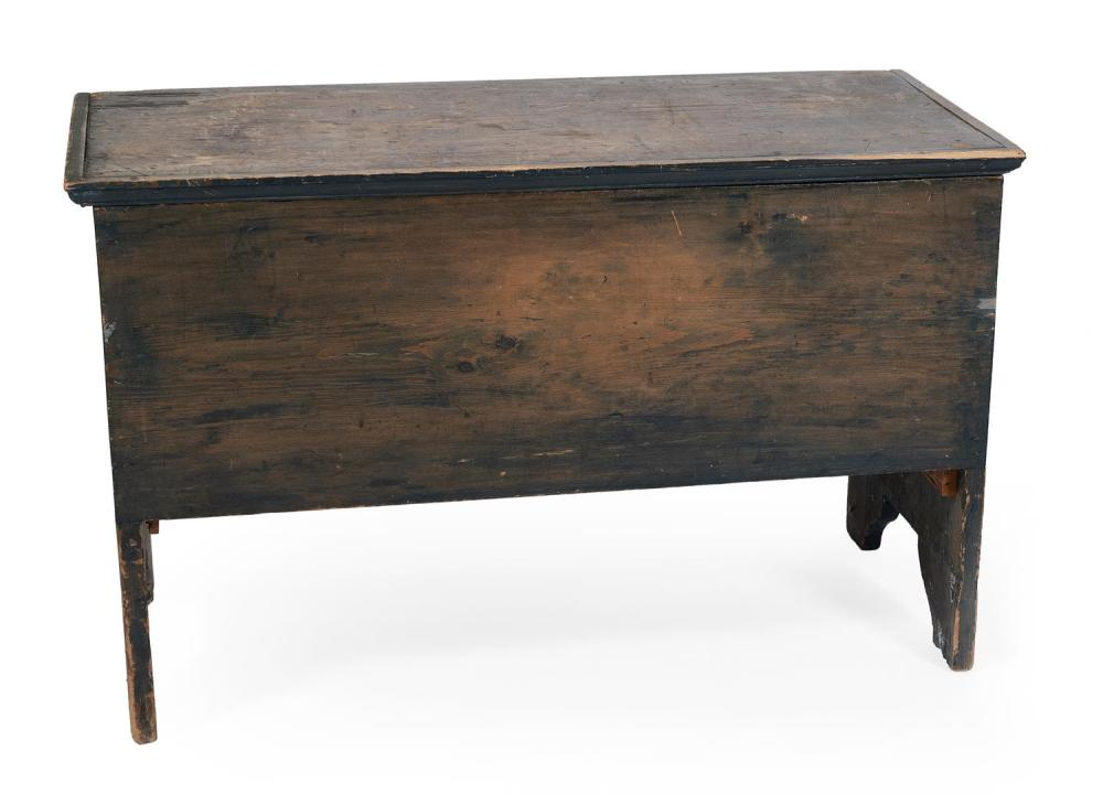 """LIFT-TOP BLANKET CHEST In pine with chestnut back panel. Shows traces of blue paint. Height 31.5"""". Width 41.75"""". Depth 20""""."""