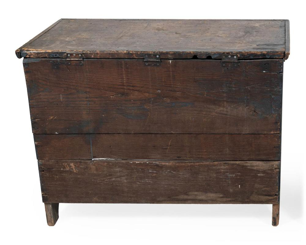 LIFT-TOP BLANKET CHEST In pine with chestnut back panel. Shows traces of blue paint. Height 31.5