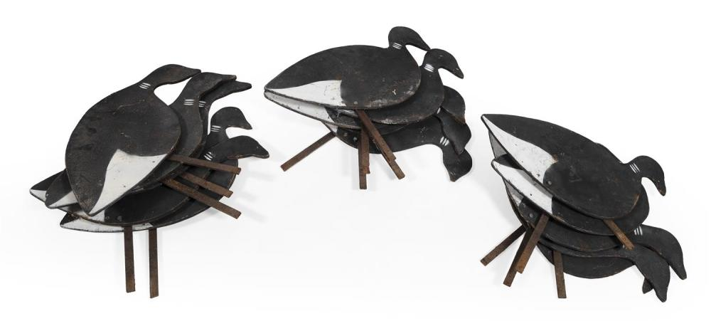 "RIG OF FIFTEEN PLYWOOD BRANT SILHOUETTE DECOYS BY CAP VINYL Branded ""CAP"". Total length 22""."