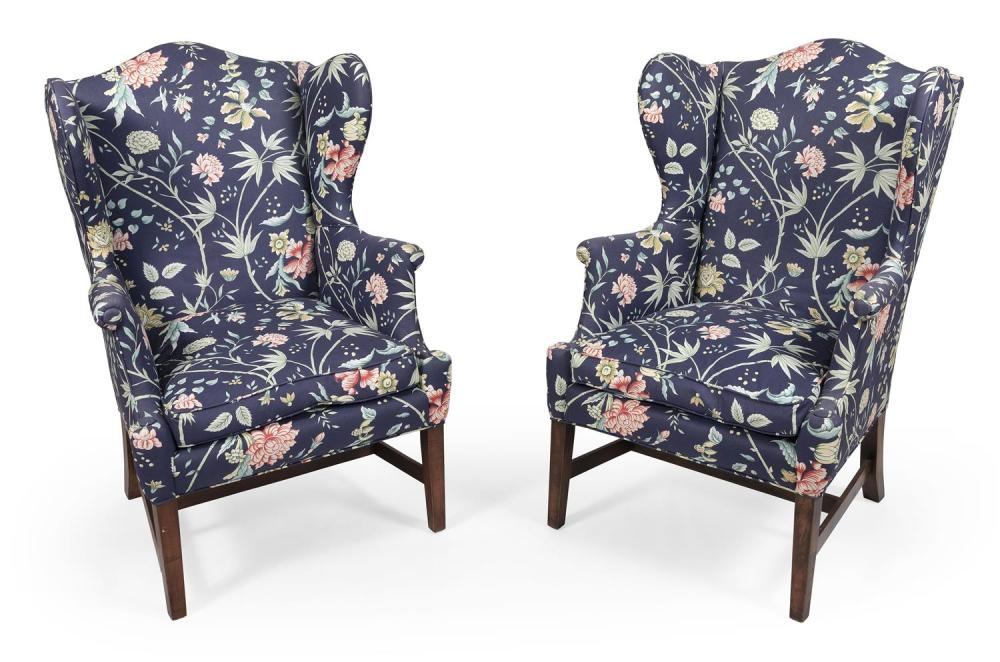 """TWO QUEEN ANNE-STYLE WING CHAIRS Blue floral upholstery. Back height 48.5"""". Seat height 20""""."""