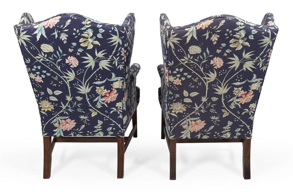 TWO QUEEN ANNE-STYLE WING CHAIRS Blue floral upholstery. Back height 48.5